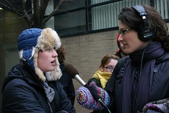 A WBEZ reporter interviews a Shimer College student at a protest in 2010