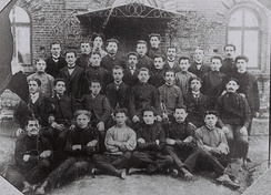 "Poalei Zion's ""Ezra"" group in Plonsk, 1905. David Grün (David Ben-Gurion) in the first row, third on the right."