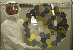 A Genesis collector array in the clean lab at Johnson Space Center. The hexagons consist of a variety of ultra-pure, semiconductor-grade wafers, including silicon, corundum, gold on sapphire, diamond-like carbon films,[9] and other materials.[10]
