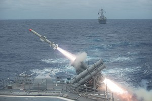 A Harpoon missile is launched from the Ticonderoga-class cruiser USS Shiloh during a live-fire exercise in 2014.