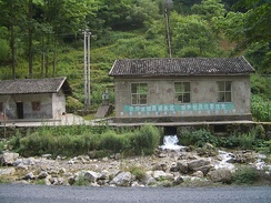 Hongping Power station, in Hongping Town, Shennongjia, has a design typical for small hydro stations in the western part of China's Hubei Province. Water comes from the mountain behind the station, through the black pipe seen in the photo