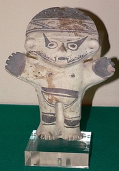 Solid clay idol called cuchimilco from the Chancay culture.