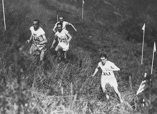 Individual cross country race at the 1924 Summer Olympics in Paris, France. The left trio is Edvin Wide, Ville Ritola and Paavo Nurmi. Due to the hot weather (over 40 °C (104 °F)) only 15 out of 38 competitors (elite long-distance runners) finished the race.