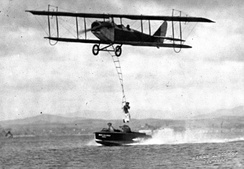 "One of the many daredevil stunts performed by JN-4 pilots was to work with a ""wingwalker""."