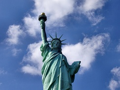 The Statue of Liberty in New York City, dedicated in 1886, is a symbol of the United States as well as its ideals of freedom, democracy, and opportunity.[146]