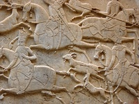 A Persian mid-relief (mezzo-rilievo)  from the Qajar era, at Tangeh Savashi in Iran, which might also be described as two stages of low relief. This is a rock relief carved into a cliff.