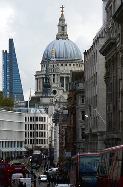 The dome and northwest tower from Ludgate Hill, showing the densely developed area in which St. Paul's is located.