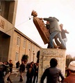 Removal of Shah's statue by the people in University of Tehran.