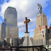 The World Trade Center Cross rises from the World Trade Center wreckage.