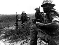 USAF Security Police from Tan Son Nhut Air Base watch for Viet Cong infiltration attempts along the base perimeter during the Vietnam war.