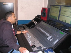 A studio engineer at a Control 24 mixing surface.