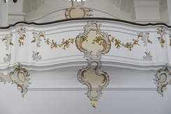18th-century Rococo balcony, Bavaria. The form is itself ornamental, and further decorated in painted plasterwork.