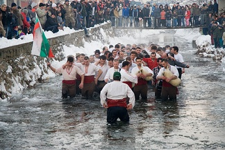 A traditional Bulgarian all-male horo dance in ice-cold water on Theophany