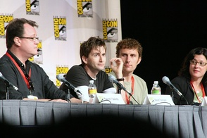 Tennant with Doctor Who showrunner Russell T Davies (left), regular director Euros Lyn (centre right), and executive producer Julie Gardner (right) at San Diego Comic-Con International in July 2009