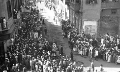 Demonstration in Egypt in 1919 holding the Egyptian flag with Crescent, the Cross and Star of David on it.
