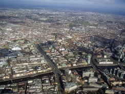 Aerial view of Dublin's Northside, with O'Connell Street in the left-foreground, Croke Park in the centre-middleground and Clontarf and Portmarnock in the background