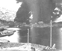 The Navy radio station at Dutch Harbor burning after the Japanese Attack, 4 June 1942