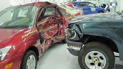A crash test by the Insurance Institute for Highway Safety shows the damage to a compact Ford Focus struck by a Ford Explorer SUV