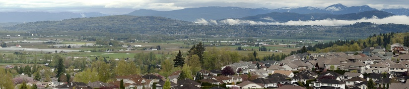 Panoramic view of the Fraser Valley as seen from eastern Abbotsford looking northwest, showing the District of Mission, which lies across the river from this viewpoint.