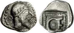 Hemiobol of Themistocles in Magnesia, where he is seen wearing a tight bonnet with Olive wreath (a similar headdress can be seen on the coinage of Kherei).[104] This possibly reflects the bonnets of Achaemenid Satraps, such as seen in the Herakleia head.[105][106] Initials Θ-Ε around portrait and on reverse.[104] c. 465–459 BC