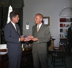 Glenn presents President Kennedy with an American flag he carried inside his space suit on Friendship 7.
