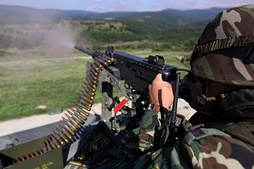 Bulgarian trooper fires an M2 Browning .50 cal machine gun at the Novo Selo training range
