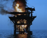 One of two Iranian oil platforms set ablaze after shelling by American destroyers