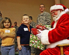 Santa Claus giving gifts to children, a common folk practice associated with Christmas in Western nations