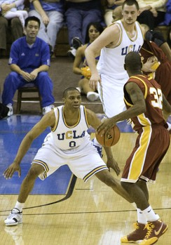 Russell Westbrook (left) and Kevin Love defend against USC