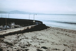 Oil piled up at the seawall near the Santa Barbara Harbor. Note the blackness of the incoming wave; the water has a thick layer of oil on top.