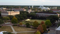 Aerial view of Bennett Auditorium (left), Lucas Administration Building (rear, dome), and Forrest County Hall (right) from the Johnson Science Tower
