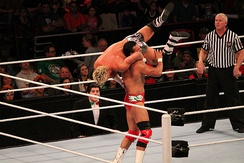 Ziggler performing a jumping DDT on Alberto Del Rio