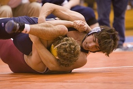 Two high school students competing in scholastic wrestling (collegiate wrestling done at the high school and middle school level)