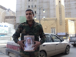 A young Benghazian carrying King Idris's photo during the 2011 civil war.