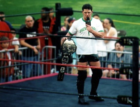 AJ Styles holding the Natural Heavyweight Championship at Ballpark Brawl IV in July 2005