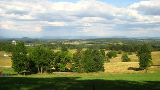 View of Augusta County countryside across the Shenandoah Valley toward the Blue Ridge Mountains.