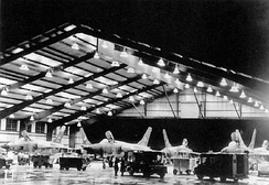 34th TFS F-105D Thunderchiefs of the 388th TFW undergo nighttime maintenance inside the big hangar at Korat in 1968. The large hangar sheltered the aircraft and its ground crews from intense tropical sunshine and heavy rains.