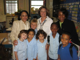 Dr. Carol R. Johnson (back row, far left), former Superintendent of the Boston Public Schools, meets students and their teacher Mrs. McClain and principal at the Bates Elementary School in Roslindale.