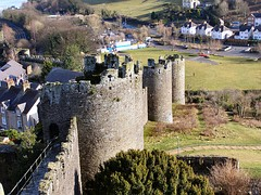 and the extensive defences of the newly planned towns, such as Conwy.