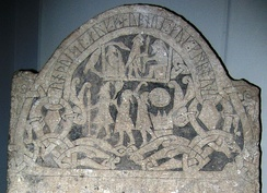A stone with various engravings upon it