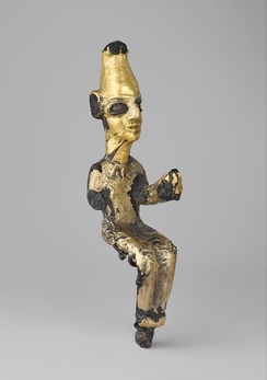Enthroned deity; 14-13th century BC; bronze and gold foil; height: 12.7 cm; Metropolitan Museum of Art (New York City)