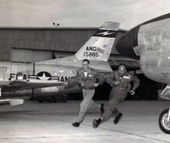 U.S. Air Force pilots 1st Lt Wally Green and Capt Dick Locker of the 159th Fighter Interceptor Squadron, 125th Fighter Interceptor Wing, Florida Air National Guard, race to their North American F-86D-25-NA Sabre fighters during an alert scramble at Jacksonville, Florida (USA), in the late 1950s