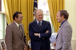 White House Chief of Staff Donald Rumsfeld (left) and his assistant Cheney (right) meet with President Gerald Ford at the White House, April 1975