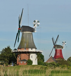 Two smock mills with a stage in Greetsiel, Germany