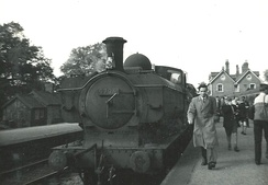 A train arriving at Brecon station on 6 October 1962, the last day of service. The steam locomotive is a GWR 5700 Class