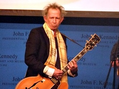 Richards paying tribute to fellow musicians Chuck Berry and Leonard Cohen at the first annual PEN Awards in the JFK Presidential Library in Boston, Massachusetts, 16 February 2012