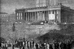 A crowd gathers outside Leeds Town Hall during the 1880 general elections.