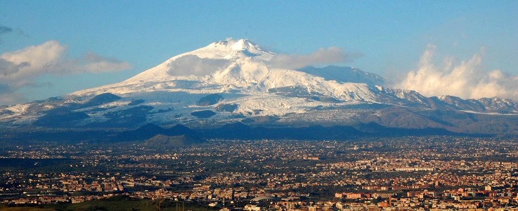 Mount Etna rising over suburbs of Catania