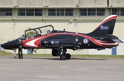 Royal Air Force Hawker Siddeley Hawk T.1A, with its pilot. This aircraft, used for aerobatic displays, is in a special colour scheme.