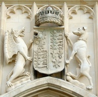 The supporters of the Royal Arms of England, such as the dragon and greyhound seen here at King's College, Cambridge, can identify specific monarchs and assist with dating ancient buildings.[24]